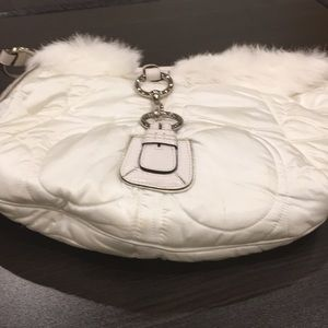 Quilted puffer coach bag with fur trim
